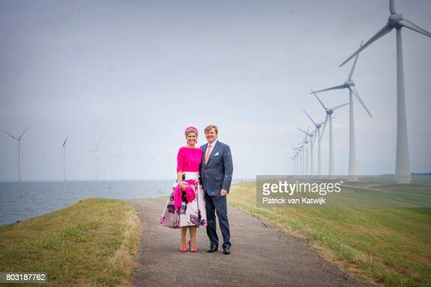 King WillemAlexander of The Netherlands and Queen Maxima of The Netherlands visit the windmillpark during their region visit to NoordOost Flevoland...