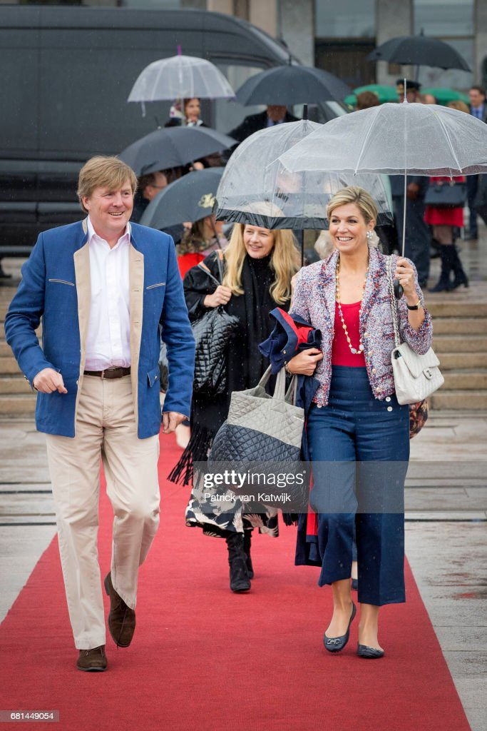 King Willem-Alexander of the Netherlands and Queen Maxima of the Netherlands walk ahead of Princess Mabel of Orange-Nassau attend a lunch on the Norwegian Royal yatch 'Norge'to celebrate the 80th birthdays of King Harald of Norway and Queen Sonja of Norway on May 10, 2017 in Oslo, Norway.