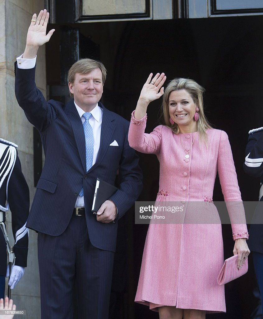 King Willem-Alexander of the Netherlands and Queen Maxima of the Netherlands wave as they leave the Royal Palace after having brunch with other guests on May 1, 2013 in Amsterdam Netherlands.