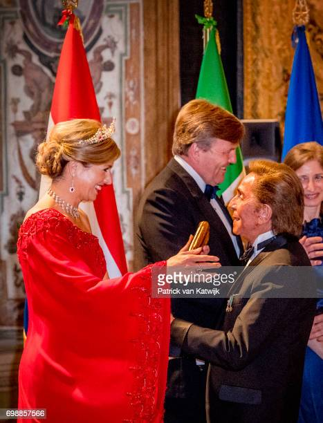 King WillemAlexander of The Netherlands and Queen Maxima of The Netherlands with designer Valentino Garavani attend the official state banquet...