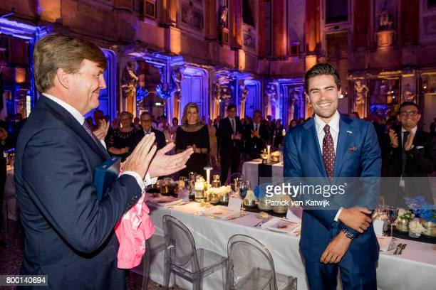 King WillemAlexander of The Netherlands congratulates Dutch Tom Dumoulin winner of the Giro D'Italia during the third day of a royal state visit to...
