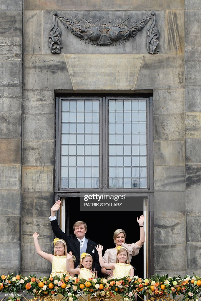 King Willem-Alexander of the Netherlands, his wife Queen Maxima (R) and their children Catharina-Amalia, Princess of Orange (front, L), Princess Ariane (front, R) and Princess Alexia (C) wave on April 30, 2013 to the crowd gathered on Dam Square from the balcony of the Royal Palace in Amsterdam, following the official abdication of Queen Beatrix of the Netherlands.