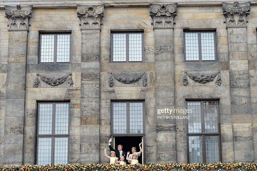 King Willem-Alexander of the Netherlands, his wife Queen Maxima (R) and their children Catharina-Amalia, Princess of Orange (front, L), Princess Ariane (front, R) and Princess Alexia (C) wave on April 30, 2013 to the crowd gathered on Dam Square from the balcony of the Royal Palace in Amsterdam, following the official abdication of Queen Beatrix of the Netherlands. AFP PHOTO / PATRIK STOLLARZ