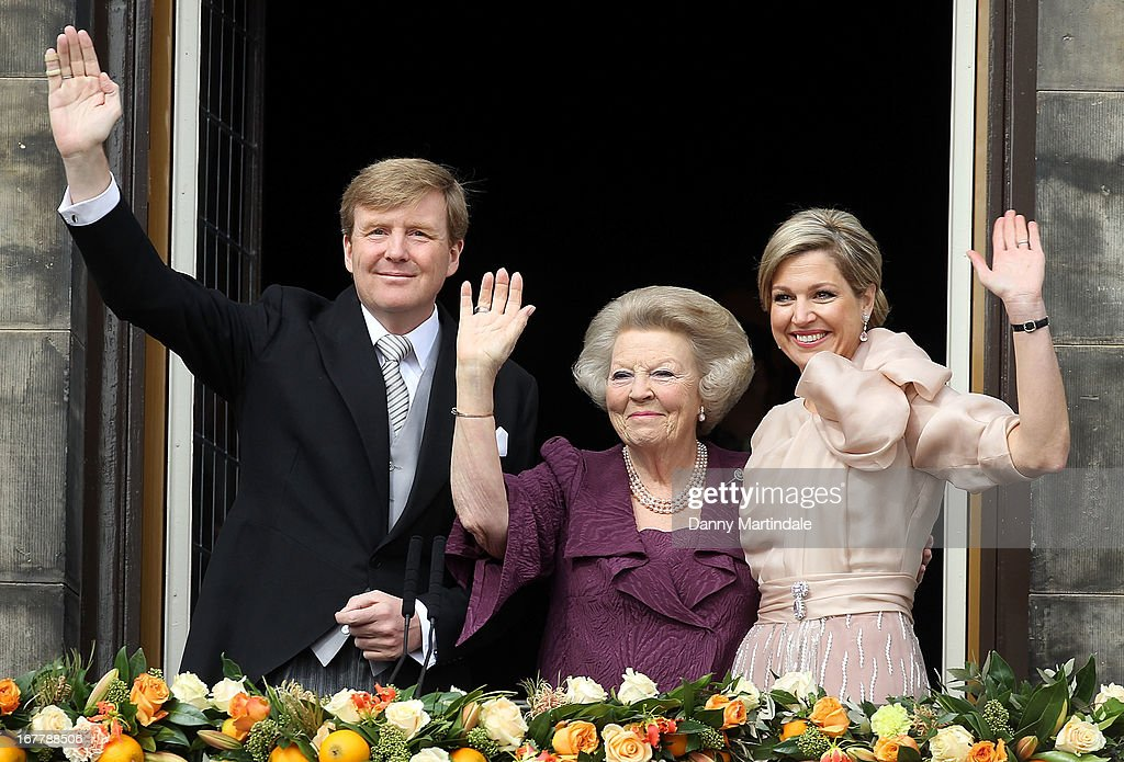 HM King Willem-Alexander of the Netherlands, HRH Princess Beatrix Of The Netherlands and HM Queen Maxima of the Netherlands appear on the balcony of The Royal Palace after the abdication of Queen Beatrix of The Netherlands and ahead of the Inauguration of King Willem Alexander of The Netherlands on April 30, 2013 in Amsterdam, Netherlands.
