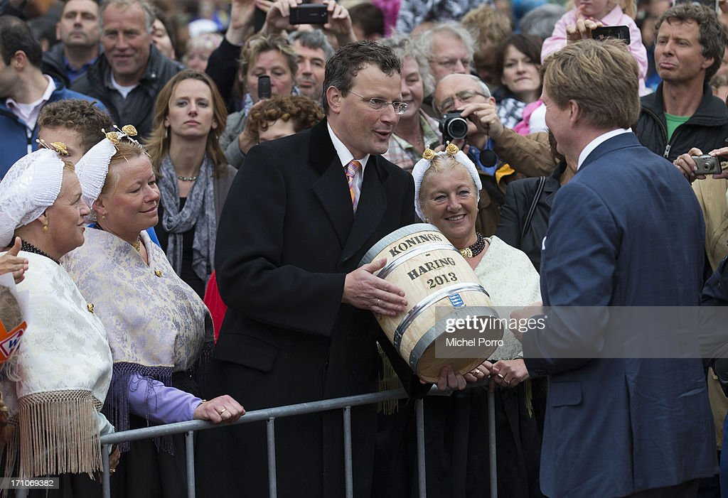 King Willem-Alexander of The Netherlands is offered a barrel of fresh herring during his visit to The Hagueon June 21, 2013 in The Hague, Netherlands.