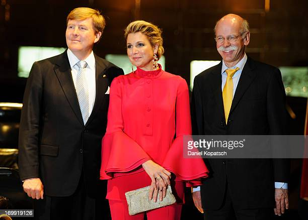 King WillemAlexander of The Netherlands Queen Maxima and Ceo of Daimler AG Dieter Zetsche pose during a visit in BadenWuerttemberg at the...