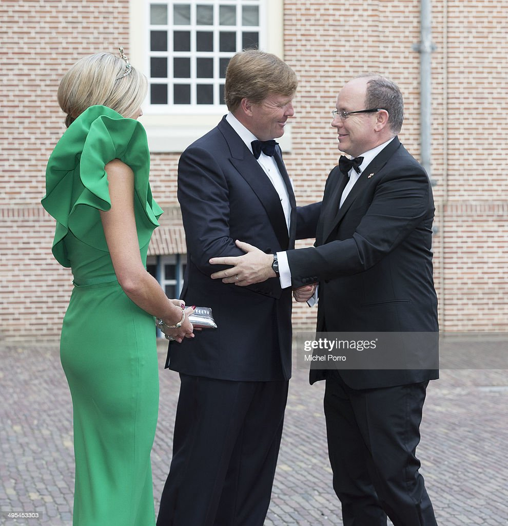 King Willem-Alexander of The Netherlands, Queen Maxima of The Netherlands and Prince Albert II of Monaco arrive for dinner at the Loo Royal Palace on June 3, 2014 in Apeldoorn, Netherlands.