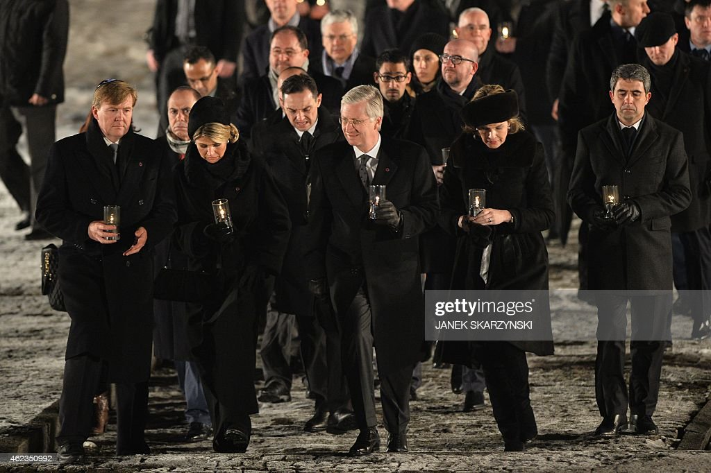 King Willem-Alexander of the Netherlands, Queen Maxima of the Netherlands, Belgium's King Philippe I and Belgium's Queen Mathilde walk to light candles to pay tribute to the victims after the main ceremony to mark the 70th anniversary of the liberation of the death camp on January 27, 2015 at the former Nazi concentration camp Auschwitz-Birkenau in Oswiecim, Poland. Seventy years after the liberation of Auschwitz, ageing survivors and dignitaries gather at the site synonymous with the Holocaust to honour victims and sound the alarm over a fresh wave of anti-Semitism.
