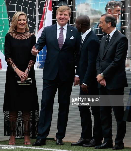 King WillemAlexander of the Netherlands Queen Maxima of the Netherlands Clarence Seedorf and mayor of Milan Giuseppe Sala attend a football clinic...