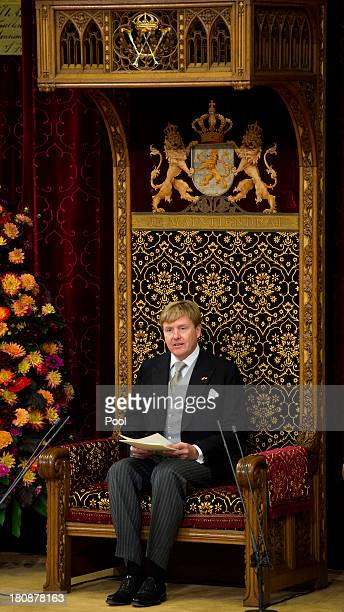 King WillemAlexander of The Netherlands reads his first budget speech during celebrations for Prinsjesdag on September 17 2013 in The Hague...