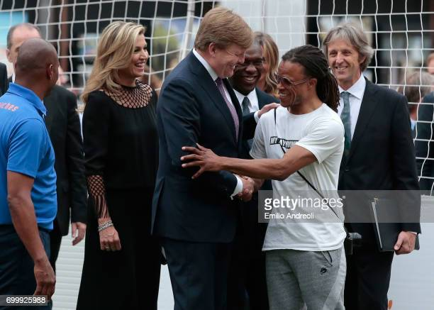 King WillemAlexander of the Netherlands shakes hands with Edgar Davids during a football clinic for integration organized by Italian Football...