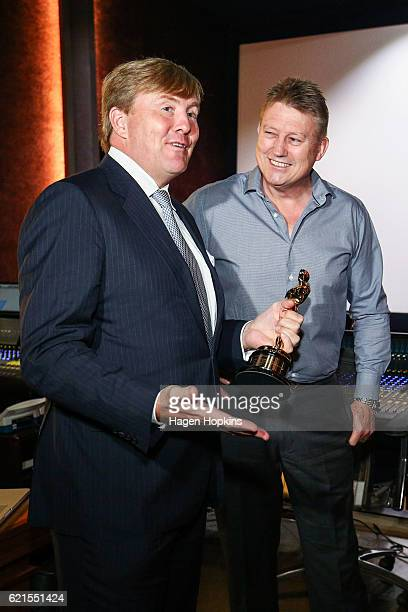 King WillemAlexander of the Netherlands speaks to Oscar winner Michael Hedges during a visit to Park Road Post on November 7 2016 in Wellington New...
