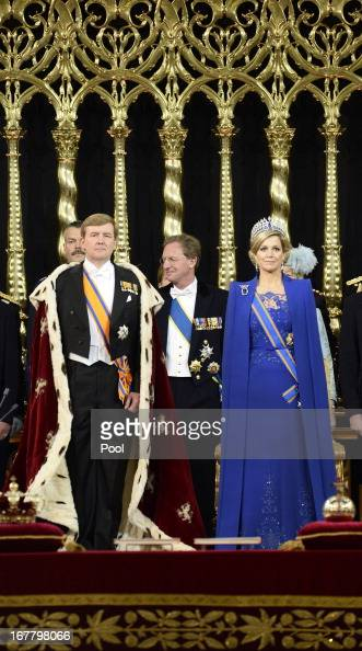 King WillemAlexander of the Netherlands stands alongside Queen Maxima of the Netherlands during his swearing in and investiture ceremony in front of...