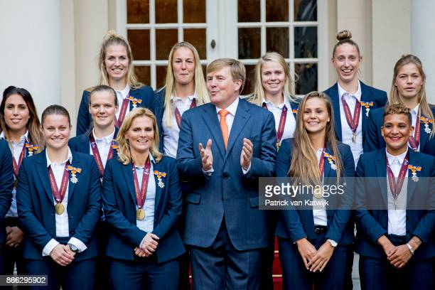 King WillemAlexander of The Netherlands stands next to Lieke Martens and Shanice van de Sanden and coach Sarina Wiegman as he and welcomes the...