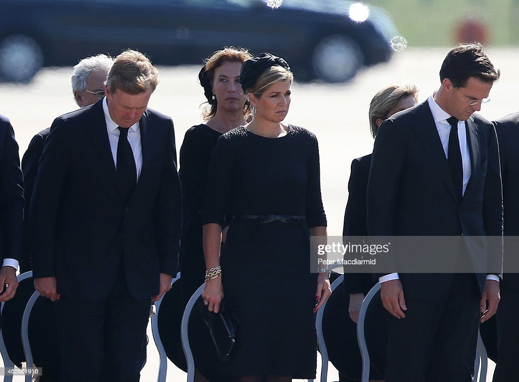 King Willem-Alexander of the Netherlands stands with Queen Maxima of the Netherlands and Dutch Prime Minister Mark Rutte as unidentified bodies from the crash of Malaysia Airlines flight MH17 are transferred to hearses on July 23, 2014 in Eindhoven, Netherlands. Today the people of the Netherlands are holding a national day of mourning. Malaysian Airlines flight MH17 was travelling from Amsterdam to Kuala Lumpur when it crashed in eastern Ukraine killing all 298 passengers. The aircraft was allegedly shot down by a missile and investigations continue to find the perpetrators of the attack.