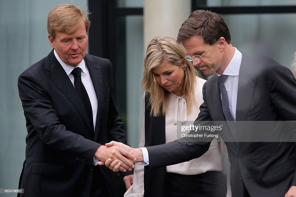 King Willem-Alexander, Queen Maxima and Dutch Prime Minister Mark Rutte (R) leave the Congresscentrum, Utrecht, after meeting relatives of the victims of Malaysia Airlines flight MH17 on July 21, 2014 in Utrecht, Netherlands. King Willem-Alexander and Queen Maxima were accompanied by Dutch Prime Minister Mark Rutte and met relatives of some of the 193 Dutch nationals who were victims of Malaysian Airlines flight MH17. The aircraft was travelling from Amsterdam to Kuala Lumpur when it crashed killing all 298 on board including 80 children. The aircraft was allegedly shot down by a missile and investigations continue over the perpetrators of the attack.