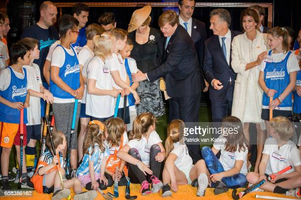 King WillemAlexander Queen Maxima of The Netherlands President Mauricio Macri of Argentina and his wife Juliana Awada visit the Hockey Clinics in the...