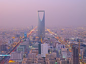 Riyadh, Saudi Arabia. the Kingdom tower is visible in the cityscape.