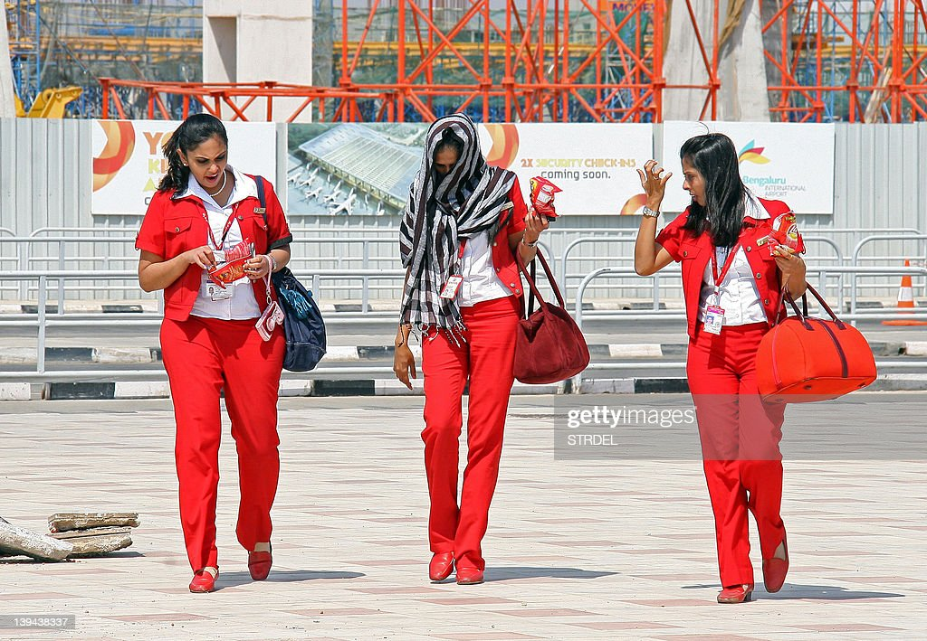 Kingfisher Airlines air hostess leave Bangalore International Airport on February 21, 2012 in Bangalore. India's Kingfisher Airlines was struggling to avoid closure as regulators ordered it to prove its operational viability after mass cancellations of flights.