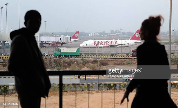 A Kingfisher Airlines Airbus A319 aircraft is seen with its cockpit windows covered due to nonoperation at the Indira Gandhi International Airport in...