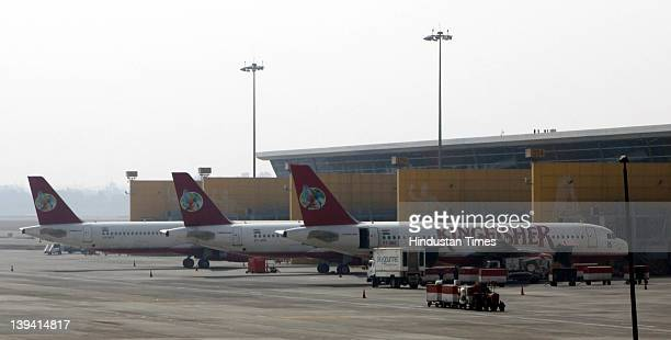 Kingfisher Airlines passenger aircraft sit grounded at the T3 terminal at the Indira Gandhi International Airport on February 20 2012 in New Delhi...