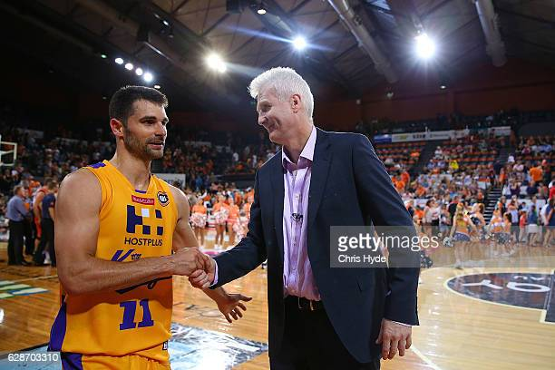 Kings coach Andrew Gaze and Kevin Lisch celebrate winning the round 10 NBL match between the Cairns Taipans and the Sydney Kings at the Cairns...
