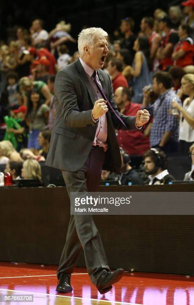 Kings coach Andrew Gaze celebrates victory in the round four NBL match between the Illawarra Hawks and the Sydney Kings at Wollongong Entertainment...
