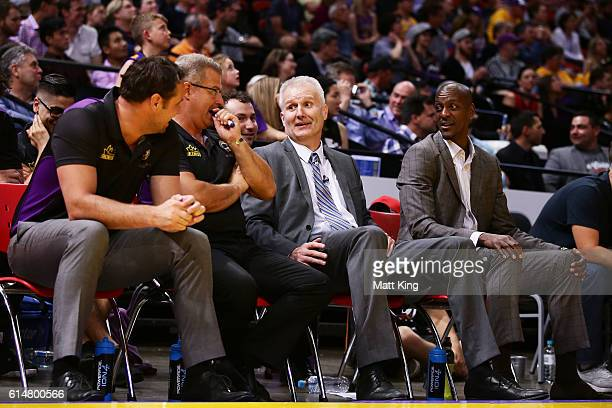 Kings coach Andrew Gaze speaks to his coaching staff during a time out during the round two NBL match between the Sydney Kings and the Cairns Taipans...