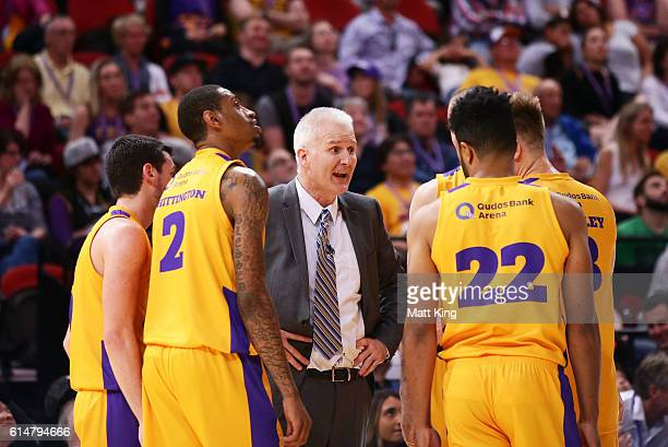 Kings coach Andrew Gaze speaks to his players during the round two NBL match between the Sydney Kings and the Cairns Taipans at Qudos Bank Arena on...