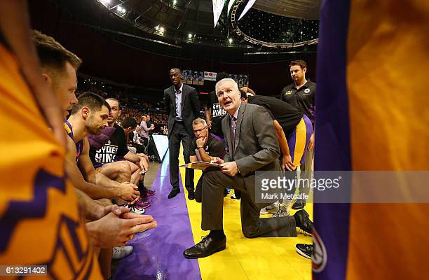 Kings coach Andrew Gaze talks to players during the round one NBL match between the Sydney Kings and the Brisbane Bullets at Qudos Bank Arena on...