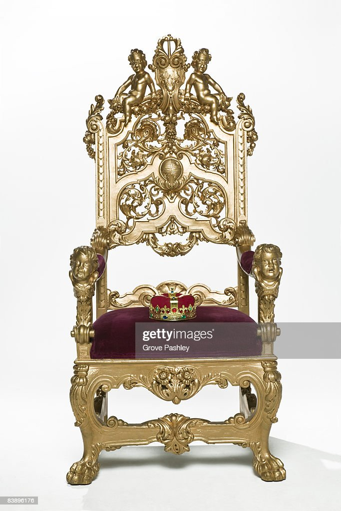 Kings crown sitting on throne : Stock Photo