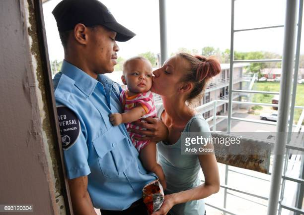 Kings Inn Hotel residents Jasiah Jones left holds his daughter Kylyah 4monthsold as she gets a kiss from her mother Krystal Bivens June 06 2017 in...