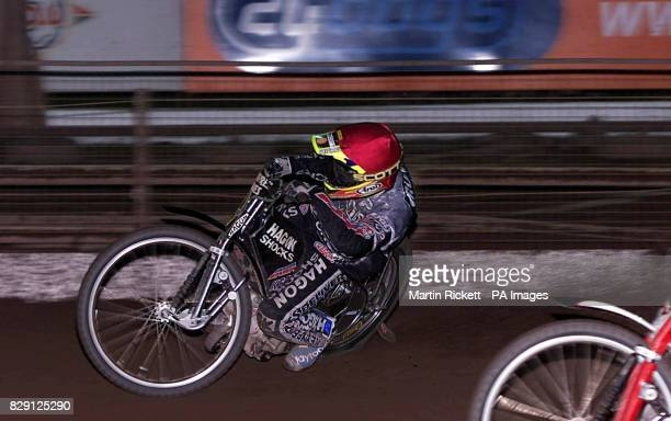 Kings Lynn Knights' Jason Crump on his way to winning the Grand Final of the the Elite League Championships at Owlerton Stadium Sheffield