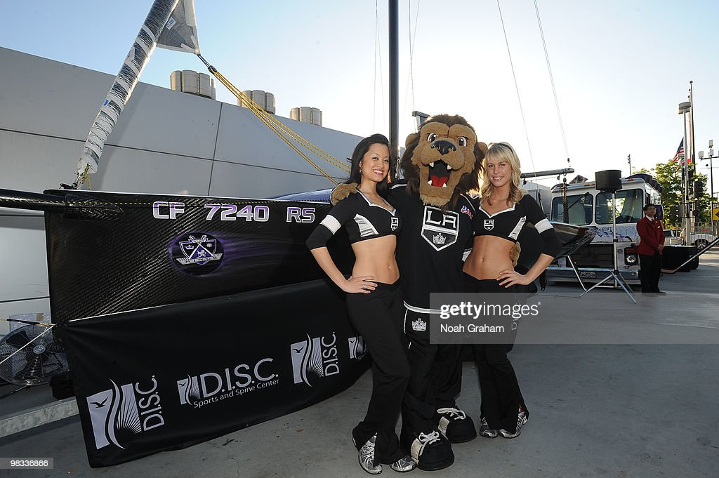 Kings mascot Bailey and members of the ice girls next to Slapshot, a sailboat built by the Los Angeles Kings and D.I.S.C. Sports and Spine Center, prior to the game between the Phoenix Coyotes and the Los Angeles Kings on April 8, 2010 at Staples Center in Los Angeles, California.