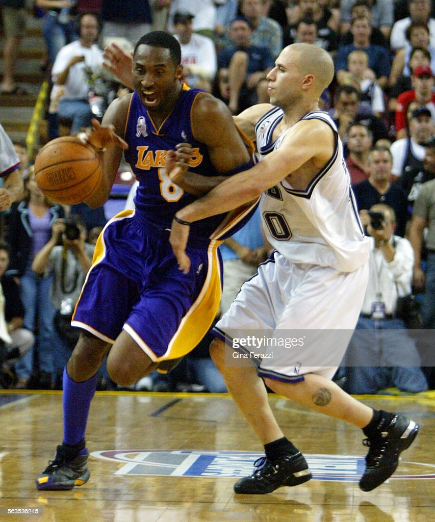 Kings Mike Bibby fouls Lakers Kobe Braynt in the final seconds of
