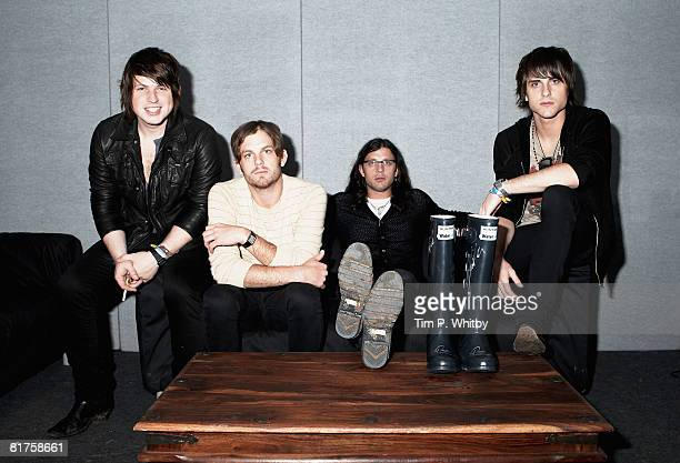 Kings of Leon pose backstage at Glastonbury Festival wearing Hunter Wellies in support of the official Glastonbury charity WaterAid in Glastonbury...