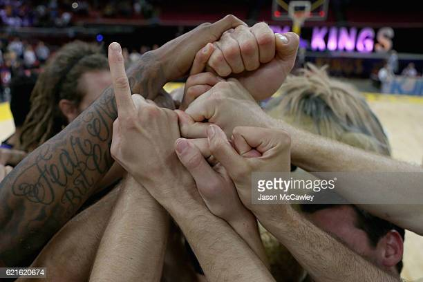 Kings players celebrate after winning the round five NBL match between the Sydney Kings and the Cairns Taipans at Qudos Bank Arena on November 7 2016...