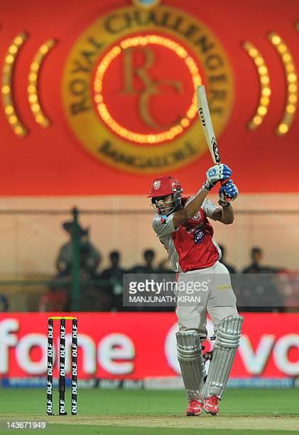 Kings XI Punjab batsman Nitin Saini plays a shot during the IPL Twenty20 cricket match between Royal Challenger Bangalore and Kings XI Punjab at the...