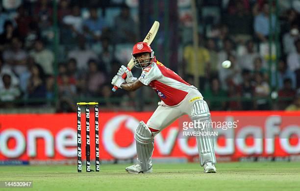 Kings XI Punjab batsman Piyush Parvinder Awana hits a ball to boundary during the IPL Twenty20 cricket match between Kings XI punjab and Delhi...