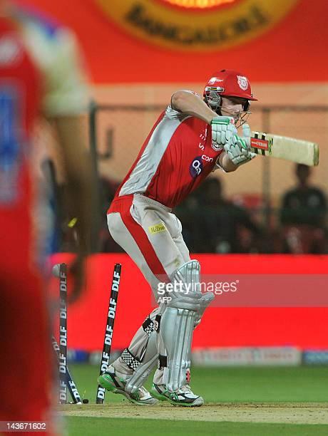 Kings XI Punjab batsman Shaun Marsh being bowlwd out by Royal Challengers Bangalore bowler Andrew McDonald during the IPL Twenty20 cricket match...