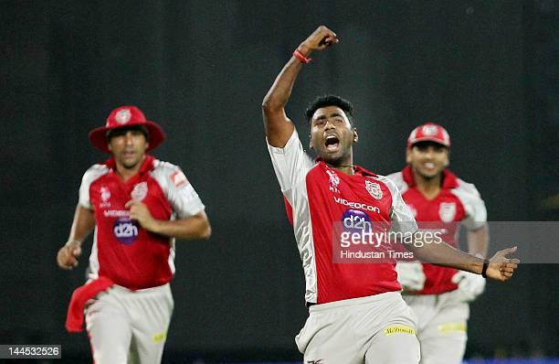 Kings XI Punjab bowler Parvinder Awana celebrates the dismissal of Delhi Daredevils Captain Virendra Sehwag during the IPL cricket match between...