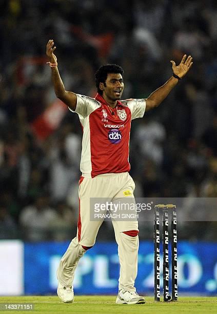 Kings XI Punjab bowler Parvinder Awana celebrates the wicket of Mumbai Indians batsman Harbhajan Singh during the IPL Twenty20 cricket match between...