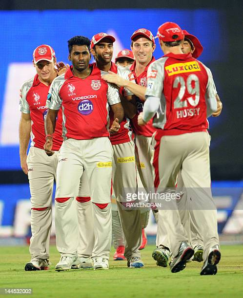 Kings XI Punjab bowler Parvinder Awana celebrates with his teammates after taking the wicket of Delhi Daredevils captain Virendra during the IPL...