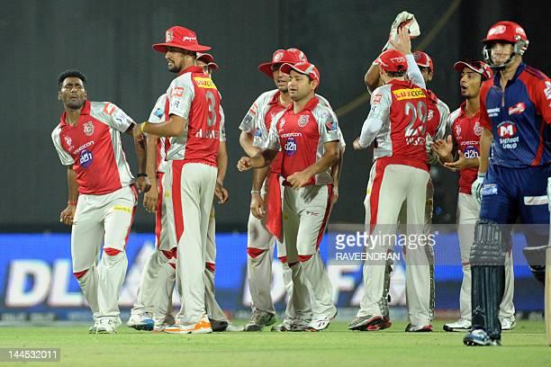 Kings XI Punjab bowler Parvinder Awana celebrates with his teammates after taking the wicket of Delhi Daredevils batsman Ross Taylor on May 15 2012...