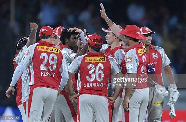 Kings XI Punjab bowler Parvinder Awana celebrates with teammates the wicket of Deccan Chargers Batsman Parthiv Patel during the IPL Twenty20 cricket...