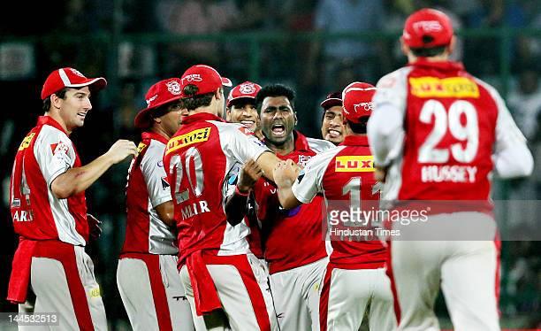 Kings XI Punjab bowler Parvinder Awana celebrates with teammates the dismissal of Delhi Daredevils batsman Ross Taylor during the IPL cricket match...