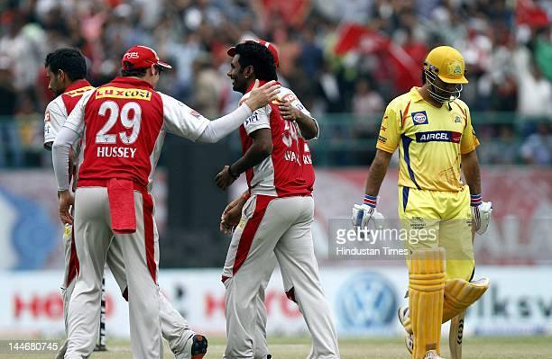 Kings XI Punjab bowler Parvinder Awana celebrates with teammates after the dismissal of Chennai Super Kings batsman MS Dhoni during IPL Twenty 20...