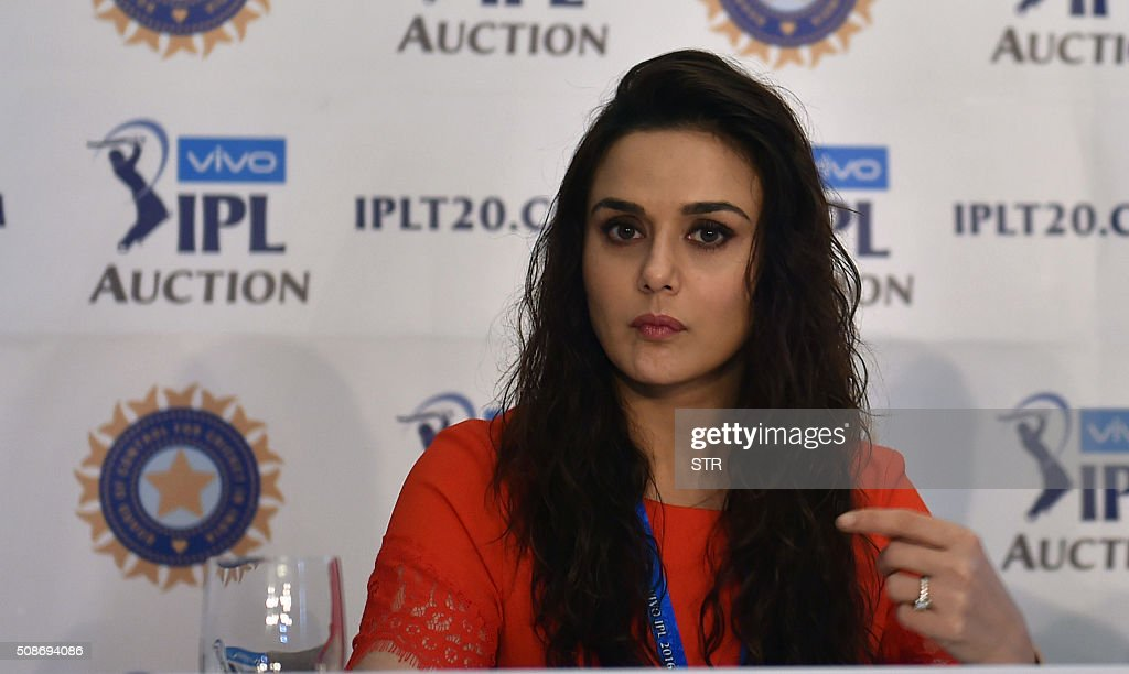 King's XI Punjab co-owner Priety Zinta gestures during a press conference at the Indian Premier League auction in Bangalore on February 6, 2016. Australian all-rounder Shane Watson received the highest bid of $1.4 million while banished England star Kevin Pietersen was sold to a new franchise at a glitzy Indian Premier League auction on February 6. AFP PHOTO / AFP / STR