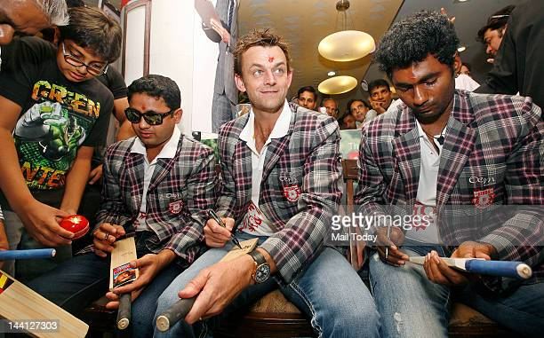 Kings XI Punjab team Members Adam Gilchrist Piyush Chawla and Parvinder Awana at a event in Delhi on Wednesday