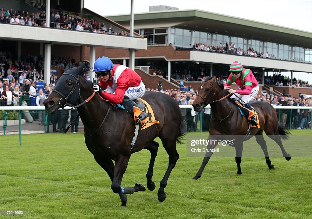 Kingsgate Native ridden by Graham Lee races clear to win The 888sport Achilles Stakes at Haydock Racecourse on May 30 2015 in Haydock England
